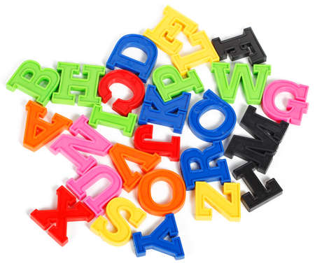 Alphabet written in multicolored plastic kids letters isolated on white background photo