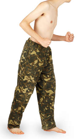 running pants: Man in military pants running isolated on white background