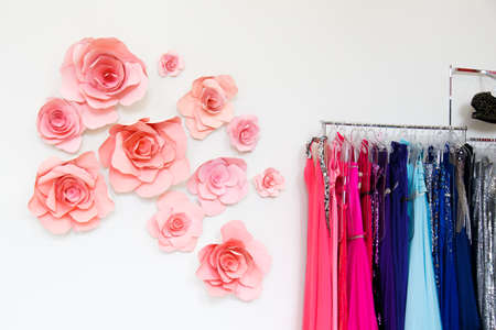 colorful dress: Dress shop with evening dresses on hangers
