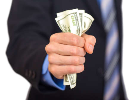 Businessman hand grabbing money on white background Stock Photo