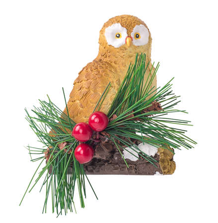 tinkering: owl sitting on a branch, red berries,christmas decoration isolated on white background Stock Photo