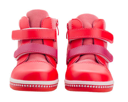red baby shoes isolated on white Stock Photo