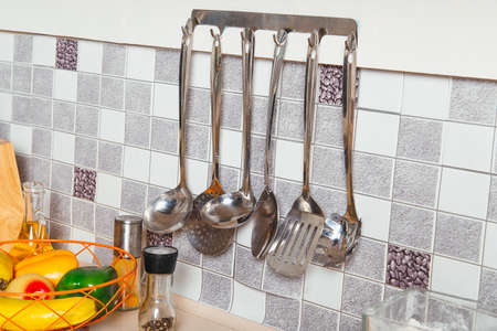 metal grater: Kitchen tools. Set of tools for cooking. Hanging on the kitchen wall