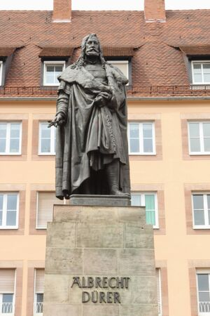 Monument to Albrecht Durer, the great artist of Renaissance, established on Durerplatz in Nurnberg, Germany Фото со стока