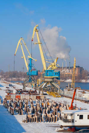 water skiers: river port in winter at sunny day