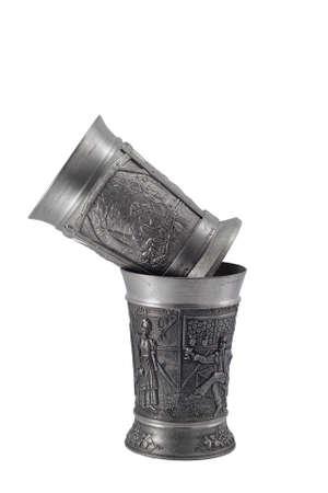 pewter mug: Two metal european wine goblets over white background