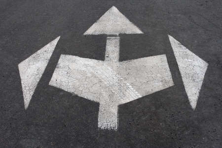 directional: directional arrow signs on the asphalt road Stock Photo