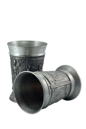 pewter mug: Two metal european wine goblets over white background