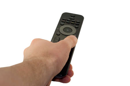 channel surfing: hand holding a remote control isolated over a white background
