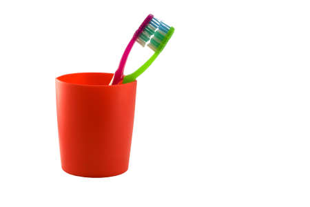 isoleted: Two toothbrushes in red glass isoleted on white background