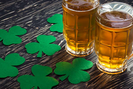 three leafed: Shamrock clover and beer - symbol of holiday St Patricks Day