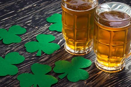 Shamrock clover and beer - symbol of holiday St Patricks Day