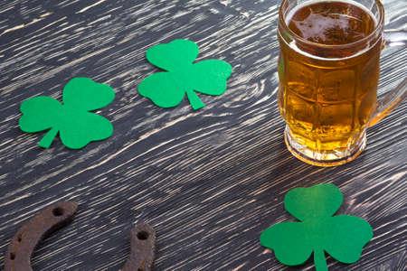 three leafed: Shamrock clover, horseshoe and beer - symbol of holiday St Patricks Day