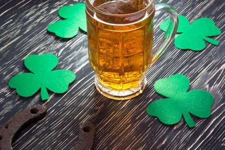 three leafed: Shamrock clover, horseshoe and beer - symbol of holiday St Patricks Day