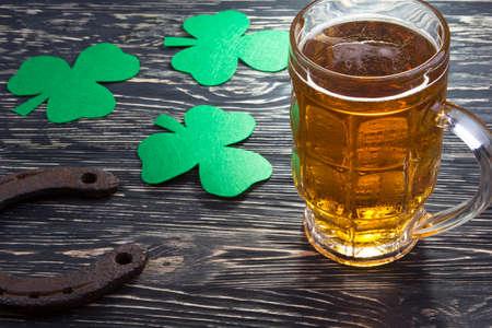 Shamrock clover, horseshoe and beer - symbol of holiday St Patricks Day