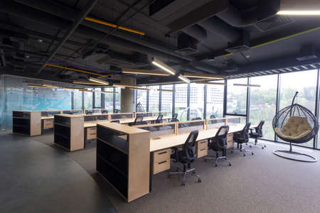 Interior Of Busy Modern Design Office With Large Windows