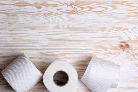 paper board: Rolls of toilet paper on wooden board