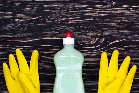 latex gloves: Detergent and latex gloves on wooden background Stock Photo
