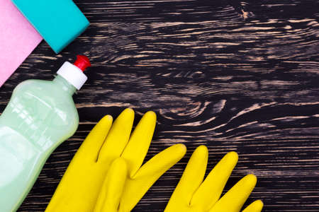 latex gloves: Detergent,sponge, rag and latex gloves on wooden background