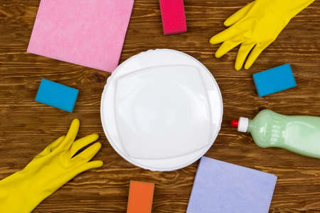 latex gloves: Detergent,sponges, dishes, rags and latex gloves on wooden background Stock Photo