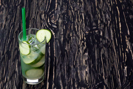 shooter drink: Summer cucumber cocktail , drink with fresh vegetable on wooden background.
