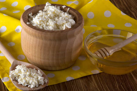 salubrious: Honey and cottage cheese on the wooden background.