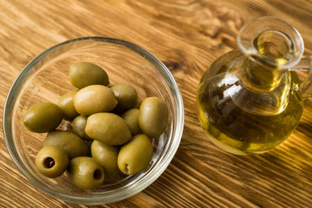 Olive oil and olive on the wooden table