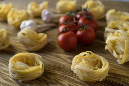 Pasta ingridients and spice on wooden background. Imagens