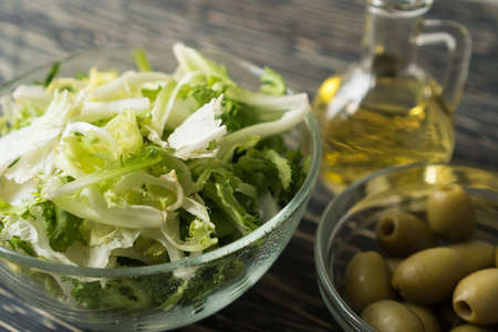 Salad leaves with olive and oil.