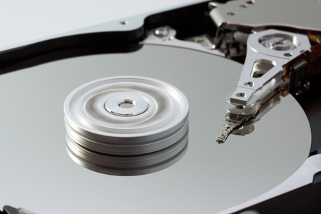 Close up of spinning computer hard drive  photo