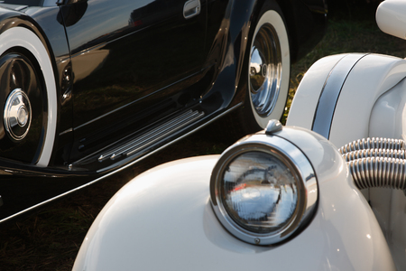 Close-up of black and white retro-styled cars photo