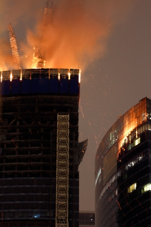 Fire on upper two floors of unfinished Federation Tower in Mocsow City business district 2012 04 02