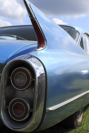 Blue tail fin and brake lights from a vintage american car