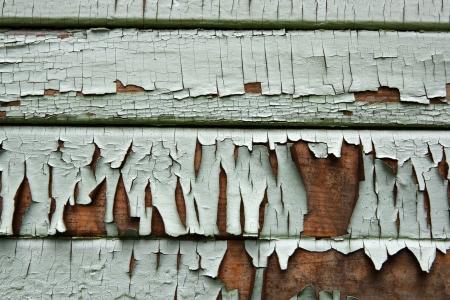 Peeling paint on an old wooden siding