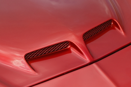 bonnet up: Close up of red sports car hood  Stock Photo