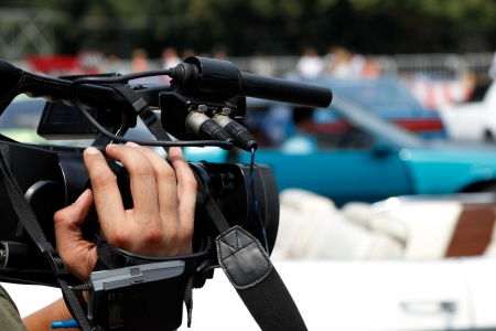 Camera in a hand of news reporter