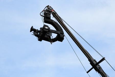 jib: Professional TV camera on a crane against sky