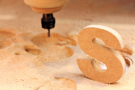 Chipboard processing on vertical CNC machining center.