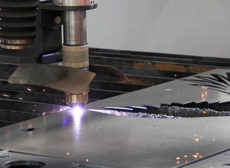 lasercutting: Cutting metal sheet with a laser cutting tool.