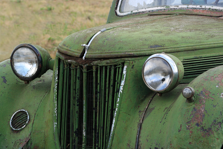 abandoned car: Old rusty vintage car in a field.