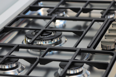 stainless steel range: The upper part of gas cooking range.