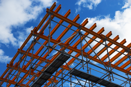 scaffolds: System of scaffolds against blue sky and clouds.