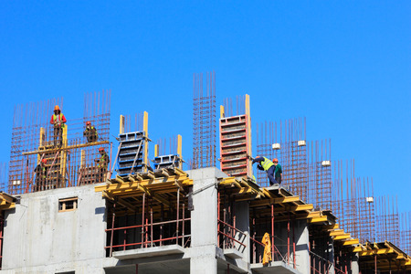 steel workers: Construction site with cast-in-place reinforced concrete structures.