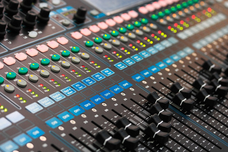 media equipment: Close up view of sound mixing console. Selective focus. Stock Photo