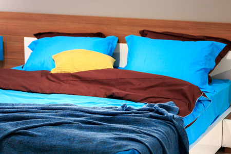 bedclothes: Double bed with bedclothes in the bedroom. Stock Photo