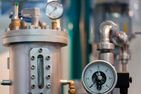 aneroid: Image of industrial equipment with focus on mechanical pressure gauge.