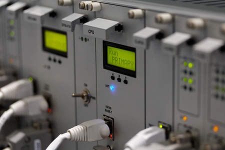Front panel of industrial computer system with I/O  connectors and cables. Selective focus on primary CPU module.