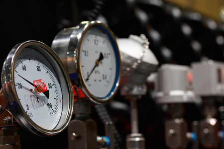 gauges: Industrial equipment with analogue every angle temperature and pressure gauges. Stock Photo