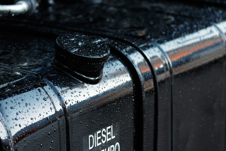 Fuel tank of diesel truck after the rain. Close up view.