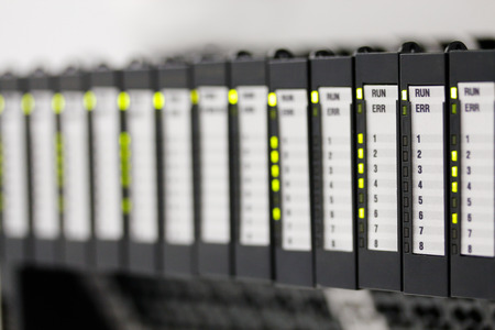 Programmable logic controllers installed in a control panel. Selective focus.
